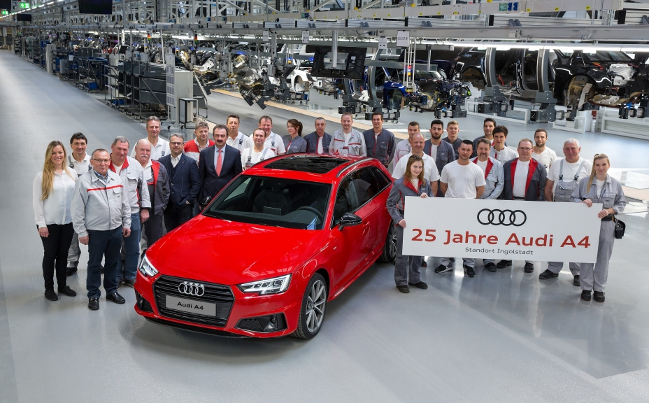 Jubilee at the Four Rings: 25 years ago the first Audi A4 drove off the assembly line at the plant in Ingolstadt. The employees and management are proud of the most successful Audi model of all time.  Picture: Employees from all production departments and from quality assurance with Plant Director Albert Mayer (front, fifth from the left) and Chairman of Audi's General Works Council Peter Mosch (front, fourth from the left